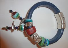 Entry by Jan Chavez.  Jan used the Dorabeth Bird Beads to make this cool Regaliz Bracelet with charms.