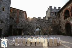 Wedding Reception set up in this historical Tuscan Castle's courtyard