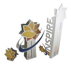 Vibrant and dynamic award set made from CNC cut aluminum, anodized and finished with Flat bed UV prints