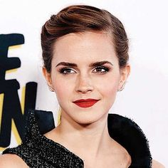 Emma Watson does the Autumnal look to a T with her smokey eyes, red lipstick, nude face make up and bushy brows.