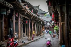 HuangLongXi Ancient Town is one of the Top Ten ancient towns in Chengdu (Sichuan, China). Read on for more travel ideas and tips of this scenic town. China Architecture, Chengdu, Angkor Wat, China Travel, Magnum Photos, Tibet, Places Ive Been, Asia, Tours
