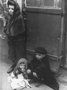 Warsaw, Poland, Children sitting on the pavement. These children who deserved so much more from life.