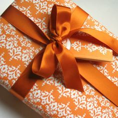✂ That's a Wrap ✂  diy ideas for gift packaging and wrapped presents - Pumpkin colored ribbon and paper.