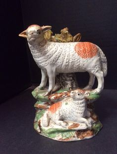 Staffordshire sheep and baby.