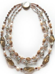 A study in copper tones. The big beads are vintage lucite, put them together with some vintage copper beads, baroque pearls, glass and seed beads. The clasp is a round moonstone box clasp. The strands measure approximately 16 to 22 inches in length.