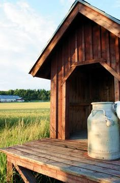 - In Canada we left our milk cans on a such a stand to be picked up to be pasteurized at Levo. Country Blue, Country Charm, Country Living, Raspberry Bush, Old Milk Cans, Goat Farming, Good Old Times, Old Farm Houses, Country Scenes