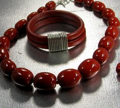 My Kazuri perfect red necklace with my lipstick red licorice leather bracelet a great combo, Available @ www.vpsjewelry.com
