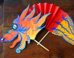 Grade First Grade Subject Holidays & Seasons Chinese New Year Social Studies Holidays What You Need: Red construction paper White construction paper Markers or colored pencils Pencil Scissors 2 wooden popsicle wooden stir sticks White glue Stapler New Year's Crafts, Diy Arts And Crafts, Felt Crafts, Crafts To Make, Crafts For Kids, Art Activities, Seasons Activities, Creative Activities, New Year Art