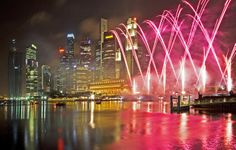 City buildings and fireworks celebrating Chinese New Year.~Singapore