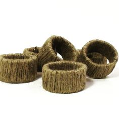 Natural Eco Friendly Jute Napkin Rings Set of 6. A set of 6 twine wrapped napkin rings. These cute, rustic napkin rings are great for everyday use. They add a rustic charm to any place setting. Dress them up with your best linens and silver, or dress them down with your everyday napkins and cutlery. Simple enough to compliment many different napkins. This is listing is for the napkin rings only, napkins are not included.