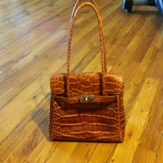 Hermes Alligator Design Leather Bag Hermes small tote purse in fabulous condition was purchased through Poshmark as a gift after I had liked it from a Hermes Poshmark Party. It has NO TAGS...NO FLAWS... PERFECT USED CONDITION! Any questions please ask! Hermes Bags Totes