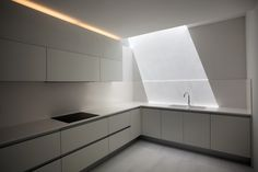 Gallery of House on the Cliff - kitchen.  Sterile looking