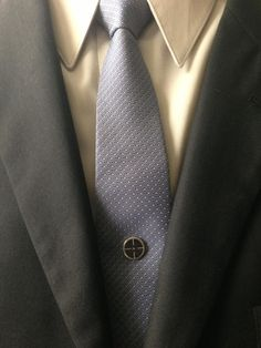 """Be """"On Target"""" with your goals and let your Tie Mag™ show that as well. Never miss that perfect style because you will always be """"On Target."""" Finished in a traditional silver color."""