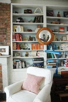 Joanna Goddard's bookshelves restyled by Jenny Komenda. Plus tutorial on how to paint back of shelves quickly