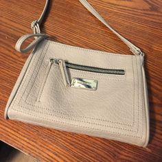 Nine West Crossbody Like new / worn a couple of times / sort of a champagne color / small zipper on the outside and also inside Nine West Bags Crossbody Bags