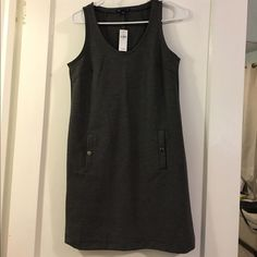 Gap tank dress NWT Fun Gap tank dress in gray. Would love to wear it with sneakers, a colorful scarf and shades but it's a little big on me. Hits above the knee. GAP Dresses