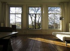 James Webb's apartment in Amsterdam / photo by James Webb - the window framing the view & flooring are the stars!