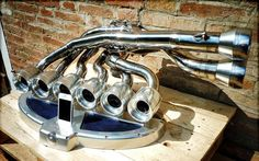 iXoost is the first audio system for iPhone/iPod entirely hand-built from solid block of aluminium, with parts such as the exhaust manifold turned and milled in Modena, Italy by local craftsmen.