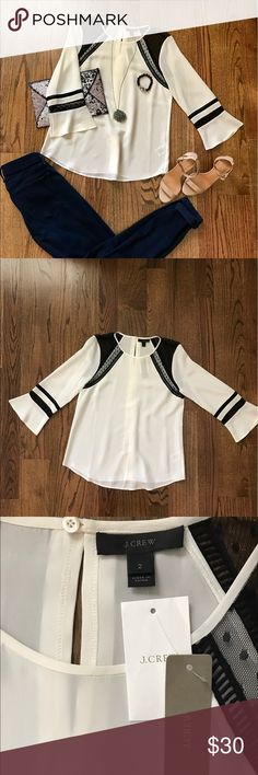 JCREW SILK TOP Off White Silk tunic style top with black lace at shoulders.  One button at back of neck.  Gorgeous flowing sleeves 24.5 inches in length. J. Crew Tops Blouses