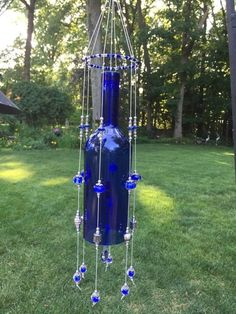 Wine bottle ideas Wine bottle wind chime Bow tie – It's different from the regular neck tie If you a Glass Bottle Crafts, Diy Bottle, Bottle Art, Glass Bottles, Wine Glass, Cutting Wine Bottles, Recycled Wine Bottles, Wine Bottle Windchimes, Glass Wind Chimes