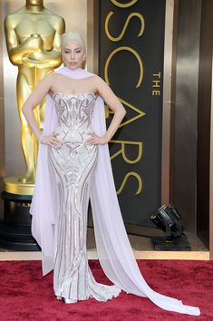 Lady Gaga worked her curves in her corseted pastel look. #oscars #redcarpet