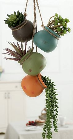 Set of 4 mini planters in a mix of blue, green, orange, and brown colors for a casual southwestern touch The brown jute rope that connects the 4 pots features a top loop designed to hang from a wall or ceiling Each pot has a drainage hole at bottom of each pot allows excess water to drain from pot **Plants not included** SPECS: Hanging Length - 30.7 H; Each Pot - 3.7 H × 3.7 Diameter (in inches) Succulent Display, Hanging Succulents, Succulents In Containers, Succulents Garden, Hanging Plants, Indoor Succulents, Plants Indoor, Hanging Gardens, Pot Plants