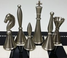 ***** all brass chess men. This listing is for a brand new 32 pc set of all brass chess men -NO BOARD . Men feature a bushed silver and antique bronze finish. Total Men Weight: - 3 Pounds 7 Ounces (without packaging)