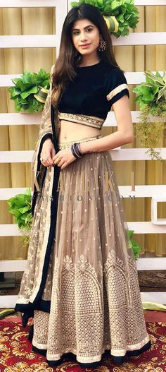 With heavy thread and zardosi work, this light brown lehenga in net gives you an unforgettable appeal. The ready velvet blouse in bottle green. Lehenga Saree Design, Half Saree Lehenga, Lehenga Blouse, Bridal Lehenga, Indian Wedding Gowns, Indian Dresses, Indian Outfits, Indian Clothes, Wedding Dress