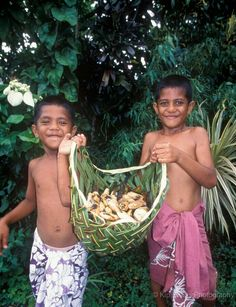 American Samoan children collecting food in a basket woven from plants. TRAVEL AMERICAN SAMOA BY MultiCityWorldTravel.Com Search Engine For Hotels-Flights Bookings Globally Save Up To On Travel Cost Easily find the best price and availabilty from all . My People, People Around The World, Water People, Moana, Tahiti, Samoan Food, Thinking Day, My Heritage, South Pacific