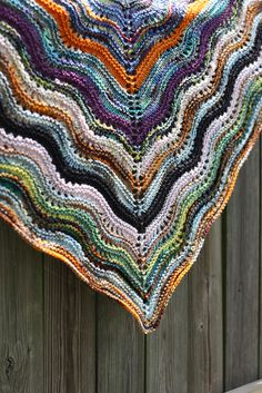 feather and fan comfort shawl.  love this scrap version by mikahsmomma.  ravelry.  free pattern.
