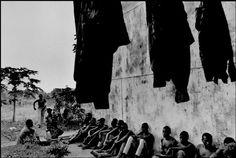 Gilles Peress - D.R. Congo. Kinshasa. 1997. Rwandans accused of being Hutu militiary. Mobutu milit. camp.