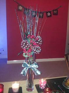 Pinecone and holly berry Christmas vase I made :)