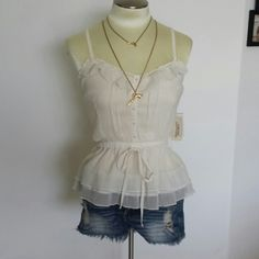 Final Sale! NWT Cream soft boho festival tank NWT Cream soft boho festival tank. Adjustable spaghetti straps. Super soft. Fits size 0 to 5. 100% polyester.  Soldout everywhere. Pair with your favorite cutoffs and gladiator sandals. Message me with any questions.  Xo Forever 21 Tops Tank Tops