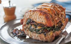 Roasted Pork Loin Stuffed with Spinach, Mushrooms and Pine Nuts // A roasted pork loin filled with tender spinach, earthy mushrooms and rich pine nuts makes a lovely dinner for guests. Pair with a simple side of whole wheat pasta or roasted root vegetables. To simplify the preparation, ask your butcher to butterfly the pork loin roast for you.