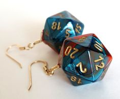 Show off your gamer side with these fun and geeky dice earrings! Standard size real and red swirled twenty sided (D20) dice with gold numbers dangle from gold filled earring wires. Perfect gift for your favorite role playing gamer - or yourself, of course. Show your gamer girl pride!  Not your color (or type of dice) of choice? Check out my other listings at http://wyrdandwired.etsy.com or let me make dice earrings in your favorite color! Length: 1 1/4 inches (3 cm) long  Earrings are…