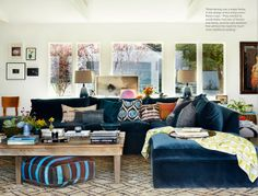 Rachel Bilson's living room. beautiful couch with gorgeous pops of color.