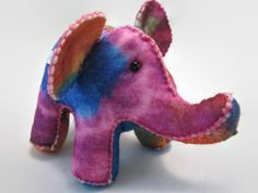 """This Trippy Elephant is a feast for the eyes, the colors are bold and mesmerizing. Someone with an open heart and mind would love this Critter.  TE is 6"""" from tail to snout, 4"""" tall, with an earspan of 4.5"""" tip to tip. Measurements vary, each Critter is a ooak, not any of them are exactly the same. That's what gives them their personality.  Cosmos Critters, if bought for a child are toys to be played with gently. Please know that small beads or buttons are used for the eyes. Please make a…"""
