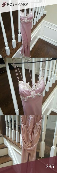 Beautiful satin blush prom dress Blush colored. Beautiful open draped back. Bodice padded front. SMALL piece of front floral design hanging off, quick fix with one or two stitches. Good condition, worn once! Dresses Prom
