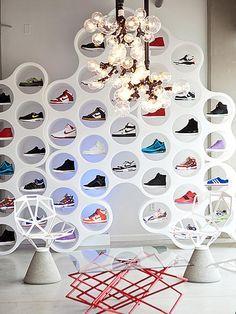 Kris Swift Interior Design. Custom Pendant Lights by the ever talented Andy Coolquitt framing Nice Kicks custom modular shoe wall.