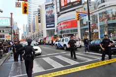 In Pictures: Emergency crews rush to a shooting at a Toronto shopping mall.