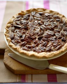 Pecan Pie: In a large bowl, whisk 4 eggs, 1 c corn syrup, 1/3 c brown & ¼ c white sugar, 4 T  melted butter, 1 t vanilla, ½ t salt until smooth; Fill pie crust w/chopped pecans. Pour mixture over the nuts; top w/ whole pecan halves. Bake in 375 deg oven (lowest rack) 50 to 60 mins.