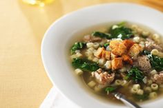 This comforting soup is a simple rendition of the traditional Italian wedding soup.  Italian sausage is cooked in Italian dressing and onions, then pasta and chicken broth are added for more simmer time.  Fresh spinach and Parmesan cheese add the perfect finishing touches to this irresistibly warm and satisfying soup.