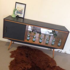 Upcycled furniture sideboard buffet. Retro modern. Glass display cabinet. Black sideboard. Atomic style legs. Vintage Burgess handle. Made by revolving_attic. Genuine vintage furniture.