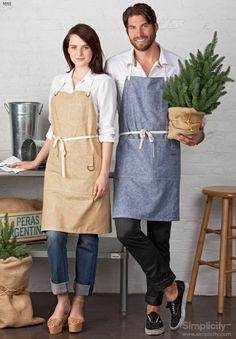 Get cooking with this farm-to-table apron! It ties around back for a perfect fit - and also includes pockets! Cafe Uniform, Adult Bibs, Aprons For Men, Apron Designs, Work Uniforms, Sewing Aprons, Recycle Jeans, Apron Pockets, Basic Style