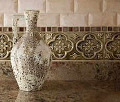 A naturally matured ancient relic vase by John-Richard is the perfect accessory to play off the tile work in this space by AVID Associates LLC of Dallas, Texas.