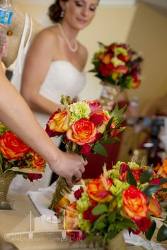 Fall Bouquets of Green Hulk Hydrangea, Mango Mini Callas, Orange Roses, Red Spray Roses, Burgundy Hypericum Berries and Wheat by Andrea Layne Floral Design  (www.andrealaynefloraldesign.com)