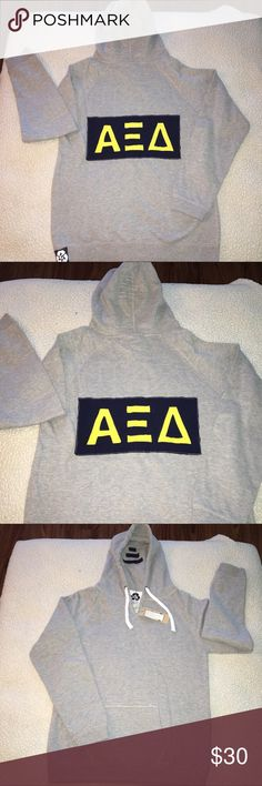 NWT alpha Xi delta Heather gray pull over hoodie NWT Alpha Xi Delta gray pull over hoodie w/ navy & gold sorority lettering. Size AL. 50% poly 46% cotton 4% rayon.  V neck, draw string in hood, logo appliqué on back & solid front. Front kangaroo pockets. Made in USA. $62 retail. RARE and one of a kind. #greek #life #college #university #alpha #xi #delta #sorority #pledge #gray #navy #big #little #sister #nwt #hoodie #vneck Never used. Smoke free home. Check closet for similar items…