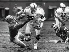 Oakland Raiders receiver Fred Biletnikoff (25) tries to escape Atlanta Falcons defensive back John Mallory (22) at Fulton County Stadium.