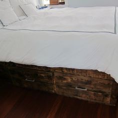 King-sized bedframe made from 200-year-old reclaimed barn wood with awesome built-in storage by Tim Sway | CustomMade