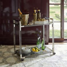 Jacques Bar Cart, lucite with brushed brass accents or moody smoke Lucite with polished nickel, and two tempered glass shelves, x x Jonathan Adler Jonathan Adler, Diy Bar Cart, Gold Bar Cart, Bar Carts, Modern Sofa, Modern Furniture, Lucite Furniture, Modern Interior, Interior Design